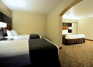 Suite with One King Bed and Two Double Beds - Non-Smoking