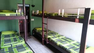 Bed in 7-Bed Male Dormitory Room with Fan