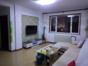 Qingdao Golden Beach Happiness Apartment, Apartmány  Huangdao - big - 9