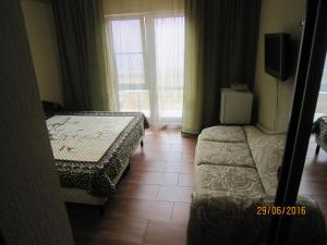Guest House on Oktyabrskaya 2, Penziony  Divnomorskoye - big - 7
