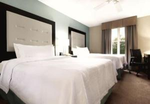 Two-Bedroom Suite with One King Bed and Two Double Beds - Non-Smoking
