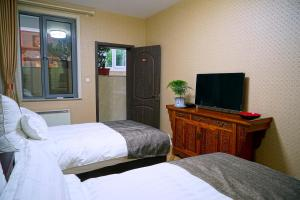 Garden Inn Beijing, Bed & Breakfast  Pechino - big - 13