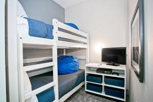 Queen Room with Two Queen Beds and Bunk Bed - Beachfront with Private Balcony