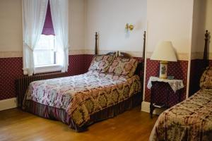 Two full sized beds with shared main hallway bathroom - bathtub and shower