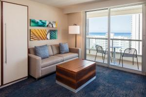 Suite with Two Double Beds and One Sofa Bed with Partial Ocean View