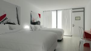 Queen Room with Two Queen Beds - Poolside View