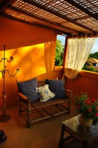 Deluxe Room with Balcony, Pool View and Garden View