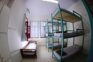 Bed in 9-Bed Dormitory Room with Shared Bathroom
