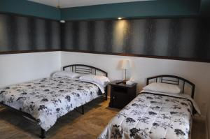 Deluxe Room with One Queen Bed and One Single Bed