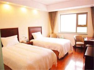Izunco Inn Qingdao Xiangjiang Road, Hostince  Huangdao - big - 6
