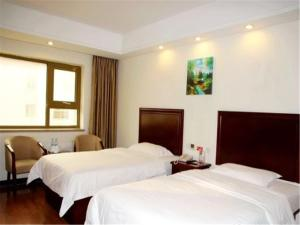 Izunco Inn Qingdao Xiangjiang Road, Hostince  Huangdao - big - 5