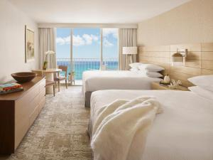 Two Queen Beds and Premier Ocean Front View