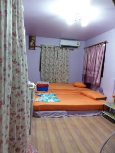 Orasa Homestay, Homestays  Sattahip - big - 46