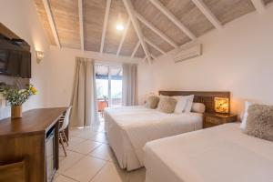 Superior Triple Room with Balcony and Partial Sea View