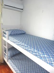 Bed in 8-Bed Male Dormitory Room with Air Conditioning