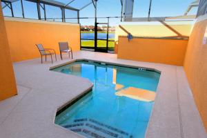 8913 Candy Palm Road Pool Home, Dovolenkové domy  Kissimmee - big - 3
