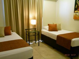 Coral Towers Holiday Suites, Apartmánové hotely  Cairns - big - 18