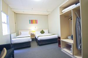 Standard one double and one single beds Room