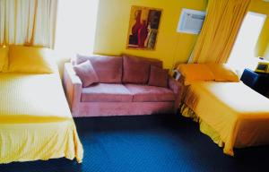 Queen Room with Two Queen Beds and Sofa Bed and Patio