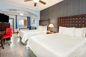 Queen Room with Two Queen Beds and Sofa Bed - Pool View