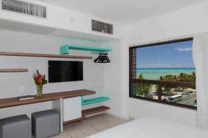 Double or Twin Room with Partial Sea View (2 Adults + 1 Child)