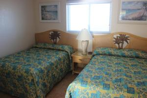 One Bedroom Suite with a Queen Bed, Double Bed Efficiency and Ocean View