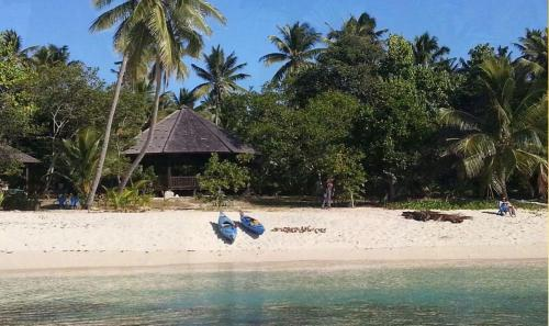 https://www.booking.com/hotel/to/serenity-beaches-resort.en.html?aid=1728672