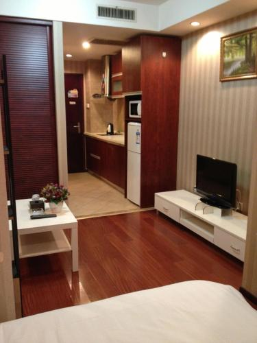 Lovely Home Boutique Apartment Hotel Beijing - Zhong Wan International, Пекин