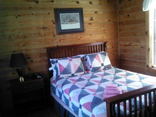 Riverside Log Cabins Photo