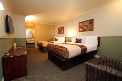 Family Garden Inn & Suites Photo