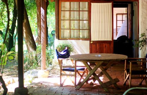 La Casa de Adobe Natural y Más Photo