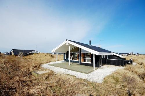 HOLIDAY HOME 259 WITH SAUNA AND TERRACE