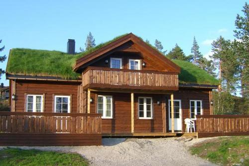 THREE BEDROOM HOLIDAY HOME IN 11