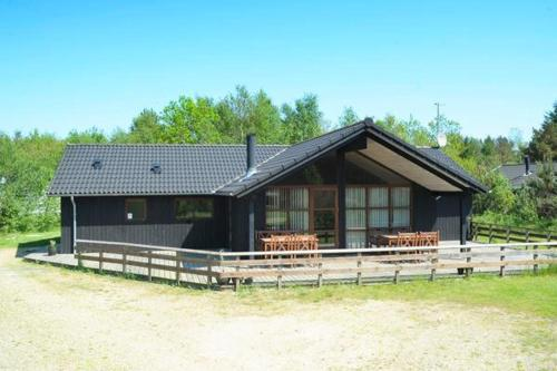 FOUR BEDROOM HOLIDAY HOME IN 13