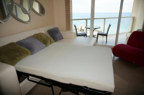 La Perla Condominium On The Beach Photo