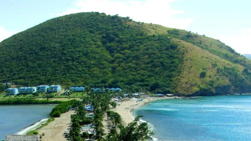 https://www.booking.com/hotel/kn/timothy-beach-resort.en.html?aid=1728672