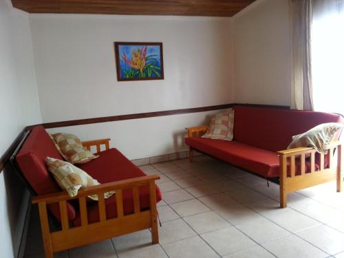 Hotel La Guaria Inn & Suites Photo
