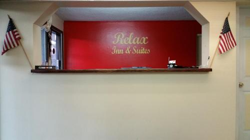 Relax Inn & Suites Photo