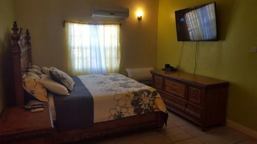 http://www.booking.com/hotel/kn/wilson-39-s-home.html?aid=1728672