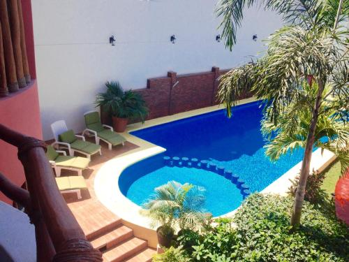 Hotel y Suites Los Encantos Photo
