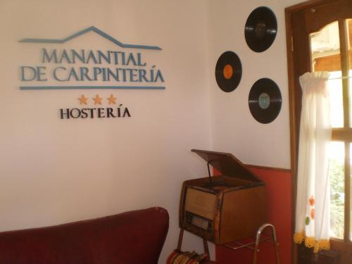 Hosteria Manantial de Carpintería Photo