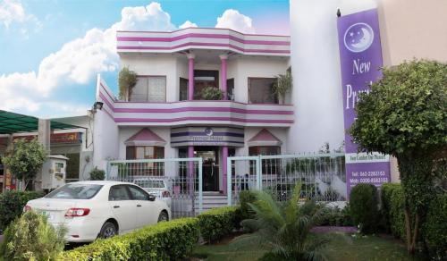 http://www.booking.com/hotel/pk/new-premier.html?aid=1728672