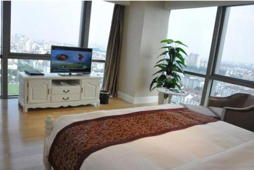 Puyu Zhongrun Apartment Hotel photo 16