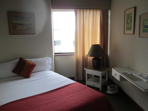 Suites Real Apart Hotel Photo