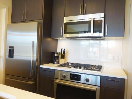 Olympic Village Living By Citiwest Photo