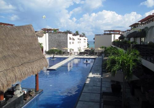 Aldea Thai Hotel Suites Photo