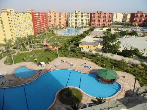 Apartment with Pool View at Golf Porto Marina -Aqua Park ( Families Only ), 阿莱曼