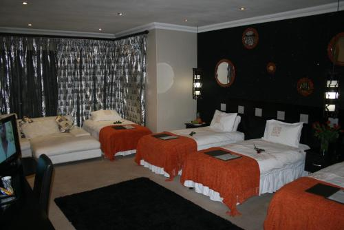 Africa Paradise - Airport Guest Lodge and Travel Centre Photo