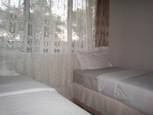 Franchise Sister Guest House Photo