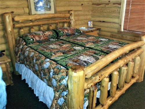 Wolf Den Log Cabins and RV Park Photo